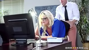 Glasses-wearing blonde is multitasking