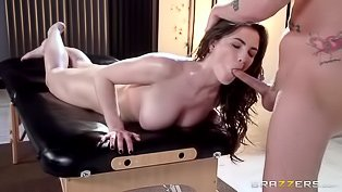 Oily brunette fucked on a massage table
